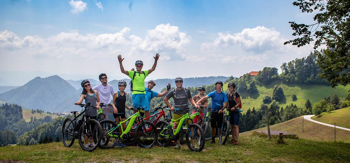 Bike and hike holidays Slovenia happy group on a bike tour